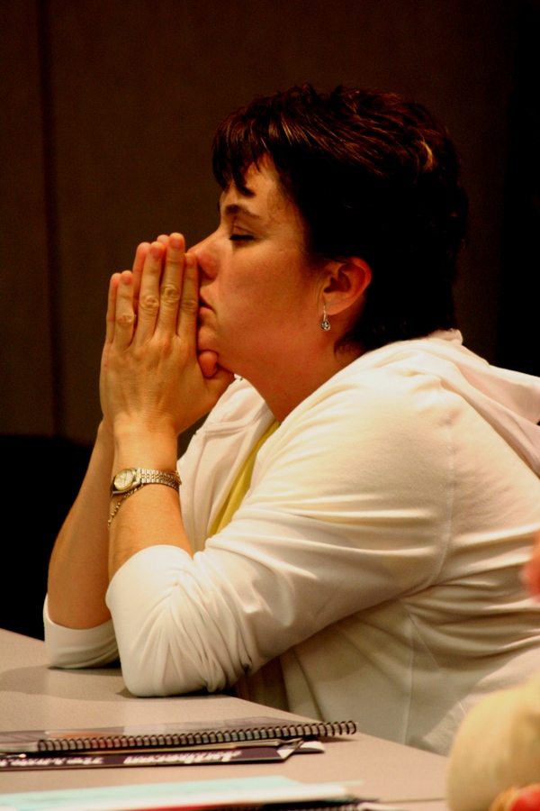 Praying at Synod Assembly